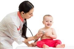 Doctor examining smiling baby Royalty Free Stock Image