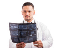Doctor examining some x-rays Royalty Free Stock Images