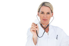 Doctor examining with stethoscope Royalty Free Stock Photos
