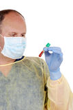 Doctor examining test tube of blood Stock Image