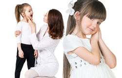 Doctor examining throat of little girl Stock Photos