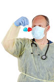 Doctor examining two laboratory samples. Isolated Doctor examining two laboratory samples Stock Photo