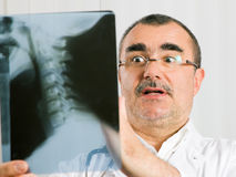Doctor examining x-ray Stock Photography