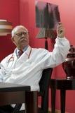 Doctor examining x-ray Stock Photography
