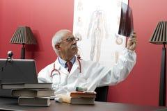 Doctor examining x-ray Royalty Free Stock Photography