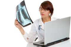 Doctor examining an x-ray image Stock Images