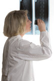 Doctor examining x-ray with loupe Royalty Free Stock Photo
