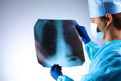Doctor examining an X-ray of the patient Royalty Free Stock Image