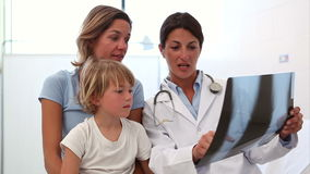 Doctor examining the Xray next to a mother and her child Royalty Free Stock Image