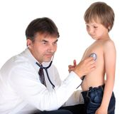 Doctor examining young boy Royalty Free Stock Image