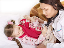 Doctor exams  child with stethoscope. Royalty Free Stock Images