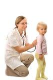 Doctor exams little girl Stock Photos