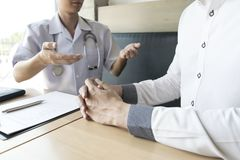 The doctor made an agreement with patients with high blood pressure to maintain health stock image