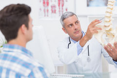 Doctor explaining anatomical spine to his patient Royalty Free Stock Images