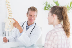 Doctor explaining anatomical spine to his patient Stock Photo