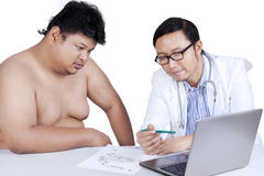 Doctor explaining the checkup result 1 Stock Photo