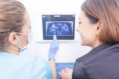 Doctor explaining dental xray Stock Photo