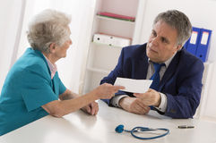 Doctor explaining diagnosis to his  patient Stock Photo