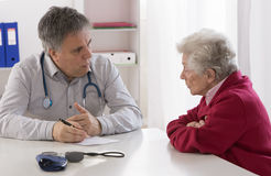 Doctor explaining diagnosis to his patient. Royalty Free Stock Images