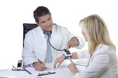 Doctor explaining function of blood pressure monitor Stock Photography