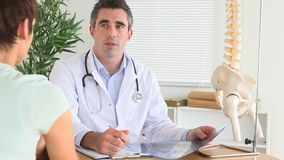 Doctor explaining an injury to a patient stock footage