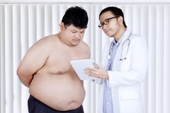 Doctor explaining the medical report to a patient Stock Image