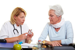 Doctor explaining medication Stock Image