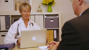 Doctor explaining medication to patient stock footage