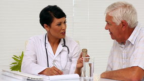 Doctor explaining medicine to patient stock footage