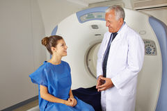 Doctor explaining MRI to patient. Radiology doctor explaining MRI to patient in a hospital stock images