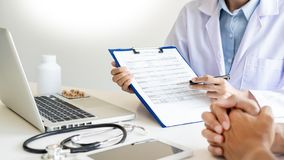 Doctor explaining for patient and showing medical records informations and diagnosis patient symptoms in a consultation and. Medical insurance concept stock photo