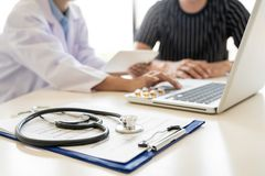 Doctor explaining for patient and showing medical records informations and diagnosis patient symptoms in a consultation and. Medical insurance concept stock images