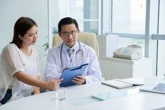 Doctor explaining prescription stock images
