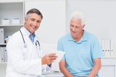 Doctor explaining prescription to senior man Royalty Free Stock Photos