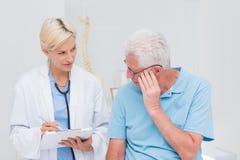 Doctor explaining prescription to senior patient Royalty Free Stock Image
