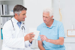 Doctor explaining prescription to senior patient Royalty Free Stock Image