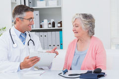 Doctor explaining prescriptions to senior patient Stock Photo