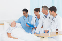 Doctor explaining report to female patient Stock Photo