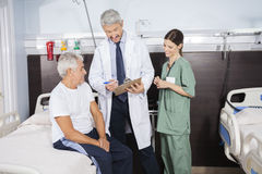 Doctor Explaining Report To Senior Patient In Rehab Center Royalty Free Stock Image