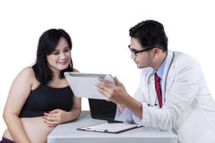 Doctor explaining result test on digital tablet Stock Photos