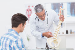 Doctor explaining a spine model to patient Royalty Free Stock Images