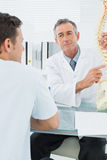 Doctor explaining spine to a patient in office Royalty Free Stock Photo