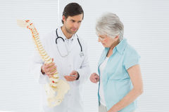 Doctor explaining the spine to a senior patient Stock Images