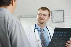Doctor explaining to patient stock image