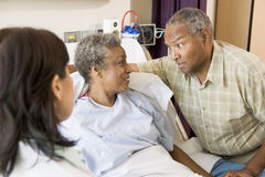 Doctor Explaining to Senior Couple Royalty Free Stock Photos