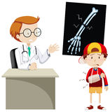 Doctor explaining x-ray film to boy Stock Images