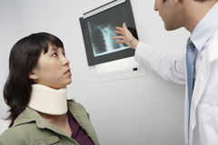 Doctor Explaining X-Ray Report To Patient Royalty Free Stock Photos