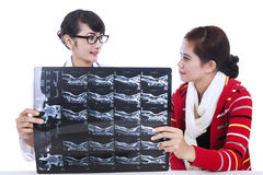 Doctor explaining x-ray results to patient Stock Photos