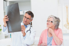 Doctor explaining x-ray to female patient Royalty Free Stock Photo