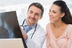 Doctor explaining xray report to a smiling patient Royalty Free Stock Images